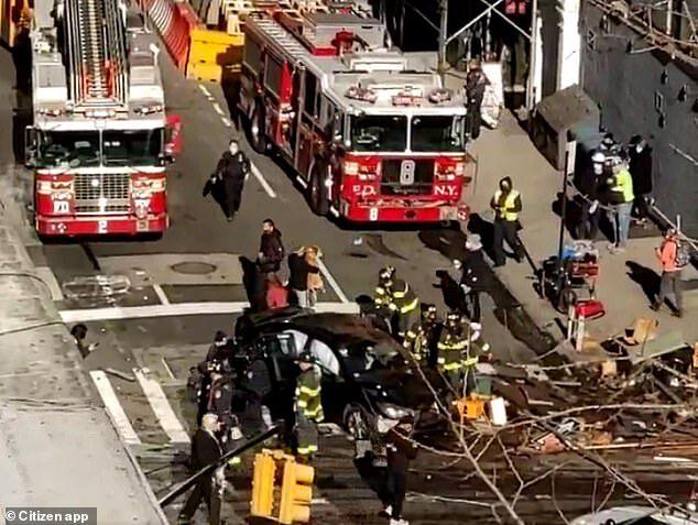 Car plows into Manhattan, Six injured