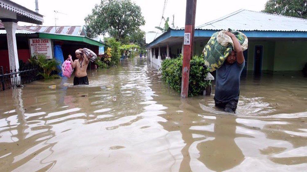 Floods, landslides kill dozens in Indonesia and neighboring East Timor