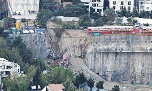 تخریب دیواره ضلع شمالی مجتمع ایران زمین برای ایمن سازی+عکس