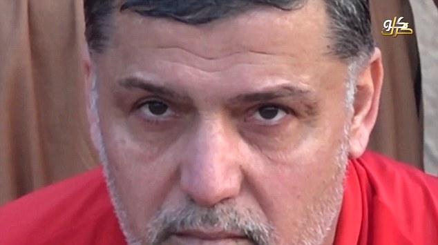 تهدید داعش برای سوزاندن نیروهای کُرد + عکس