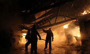 آتشسوزی گسترده 3 مغازه در خیابان فردوسی/ نجات 6 کارگر افغان از میان شعلههای آتش