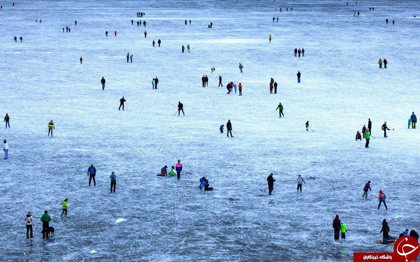 اسکیت بازی روی دریاچه ای یخ زده در سوئیس + عکس