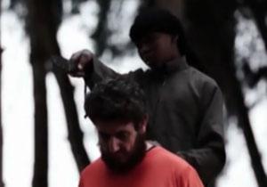 سر بریدن یک مرد به دست جلاد نوجوان داعش + فیلم(18+)