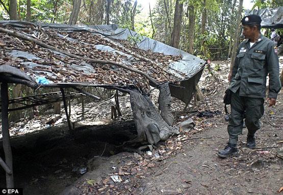 کشف گور جمعی مهاجران غیرقانونی در تایلند(تصاویر18+)