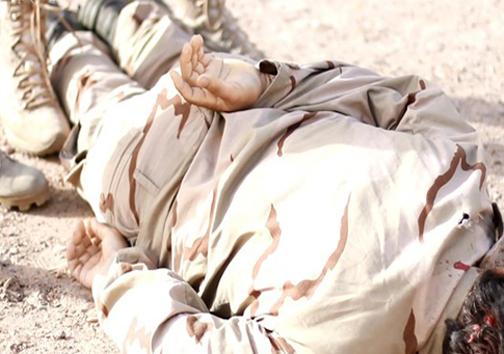 قربانی کردن نظامی کُرد در مراسم بیعت عشایر فلوجه با داعش + تصاویر