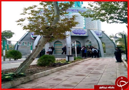 گلباران قبور شهدای استان مرکزی زیر باران+تصاویر