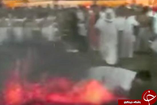 مردی که روی زغال گداخته سینه خیز می رود + تصاویر