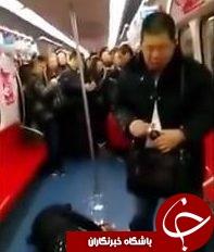 تصاویری از لحظه وحشتناک خودکشی دسته جمعی در متروی پکن (18+)