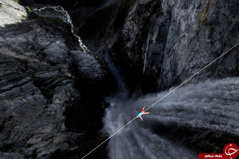 عبور بندباز حرفه ای از یکی از بلندترین آبشارهای جهان+ عکس