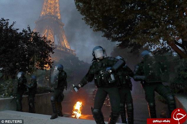 واکنش هواداران فرانسوی پس از باخت در برابر پرتغال/برج ایفل غرق گاز اشک آور شد + تصاویر