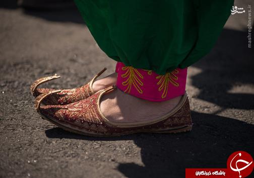 عکس/ لباس دختر افغان سوژه عکاسان المپیک