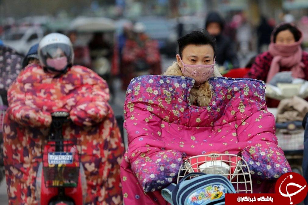 عکس/ پوشش عجیب موتورسواران چینی برای مقابله با باد و سرما