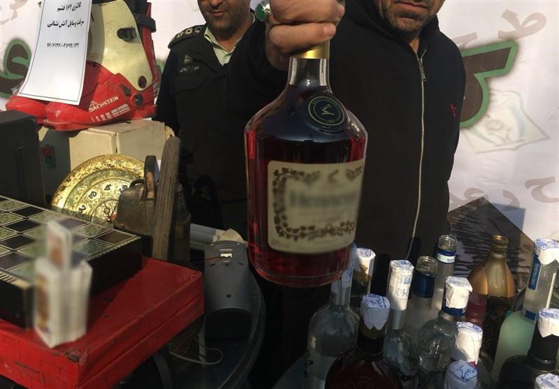 تجارت سیاه با جمعآوری بطری مشروبات خارجی از میان زباله + عکس