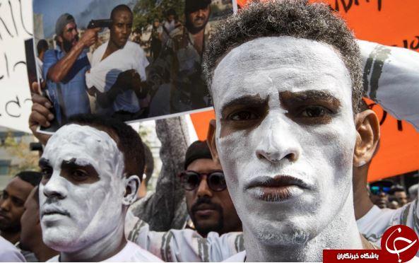 تصاویر روز: از اعتراض مهاجران آفریقایی به رژیمصهیونیستی تا اسکیسواری در مقابل برج ایفل