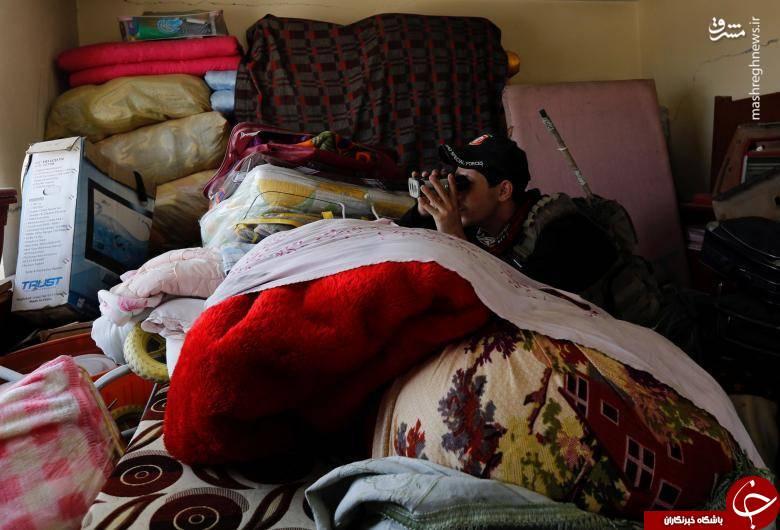 عکس/ کمین سرباز عراقی پشت رختخواب
