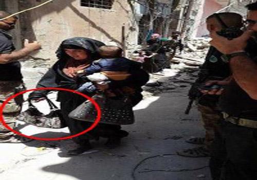 عملیات انتحاری زن داعشی بههمراه کودکی در آغوش+تصاویر