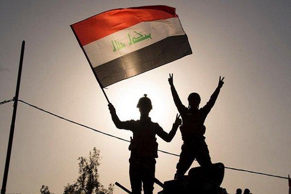 صحنه برافراشتن پرچم عراق بر فراز حیالکفاح + فیلم