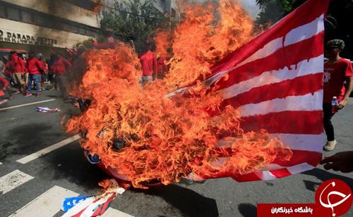 تصاویر روز: از آتش زدن پرچم آمریکا در مانیل تا آشفتگی کبوترها در هوای آلوده لاهور