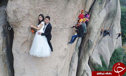 تصاویر روز: از ازدواج عجیب زوج چینی برفراز صخره صعب العبور تا بارش برف پاییزی در آلمان