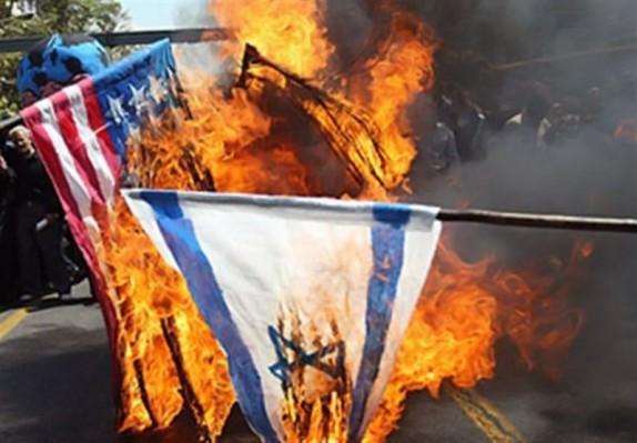 باشگاه خبرنگاران -پرچم آمریکا و رژیم صهیونیستی در دشتستان به آتش کشیده شد