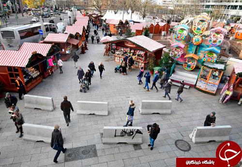تصاویر روز: از ابتکار عمل شهروندان آلمانی برای جلوگیری از حملات تروریستی تا تزئین کاخ سفید با شکلات و ربانهای قرمز