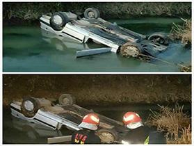 عملیات ۱۲۵ درپی واژگونی خودرو در کانال آب