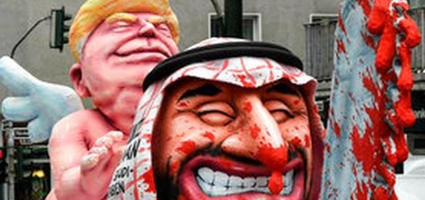 حضور ترامپ و بن سلمان با اره خونین در بزرگترین کارناوال آلمان + تصاویر