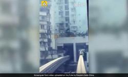 ریل قطاری که از یک آپارتمان مسکونی عبور میکند + فیلم
