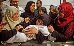باشگاه خبرنگاران -تصاویر روز: از فوران آتشفشان کیلاویا در هاوایی تا پیکر بیجان نوزاد هشت ماهه فلسطینی در آغوش مادرش