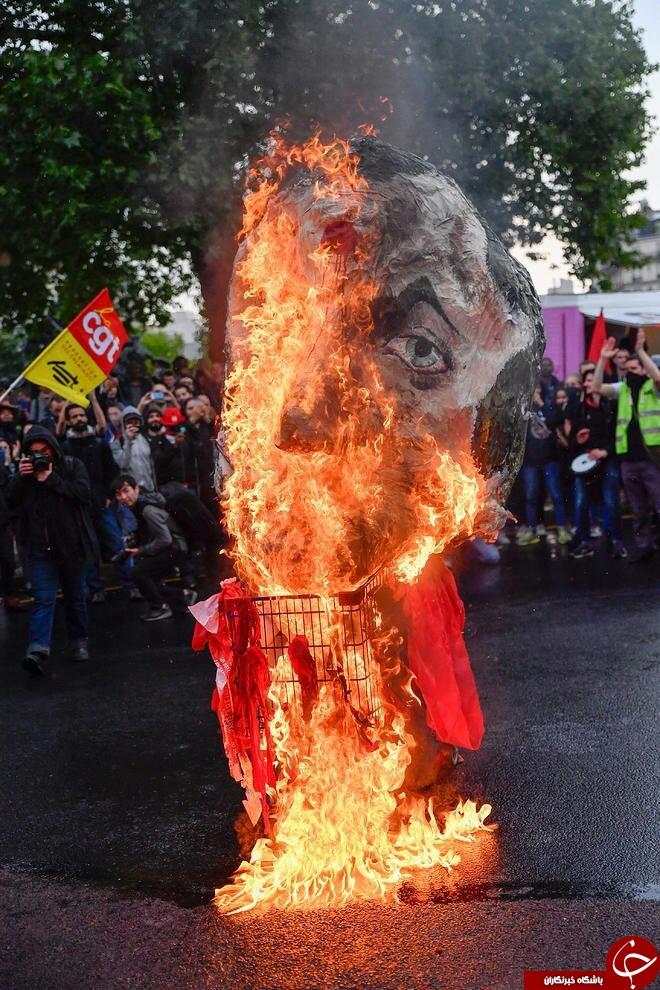 آتش زدن آدمک رئیس جمهوری فرانسه در تظاهرات اعتراضی کارگران + تصاویر