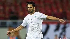 کاپیتان تیم ملی فوتبال در کنار ستاره اروگوئه