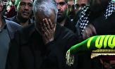 تبرک جستن حاج قاسم سلیمانی به پرچم حرم امام رضا (ع)+فیلم