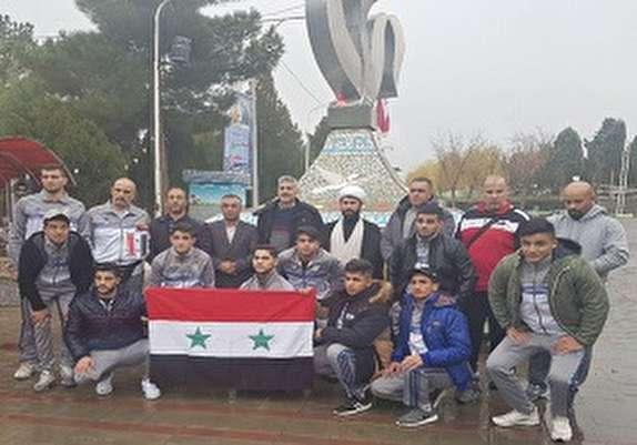باشگاه خبرنگاران - ادای احترام به مقام شامخ شهدا توسط اعضای تیم کشتی سوریه