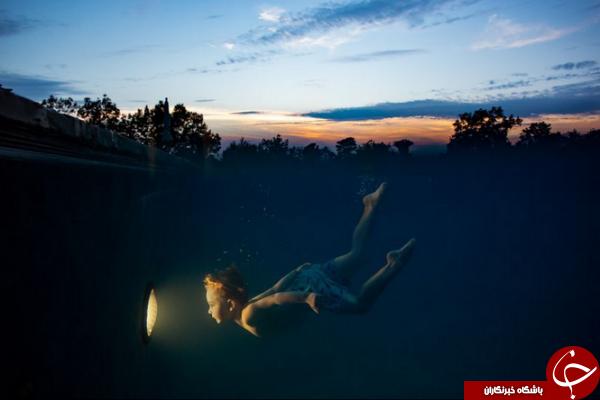 عکس روز نشنال جئوگرافیک از شنای پسربچهای در تاریکی شب