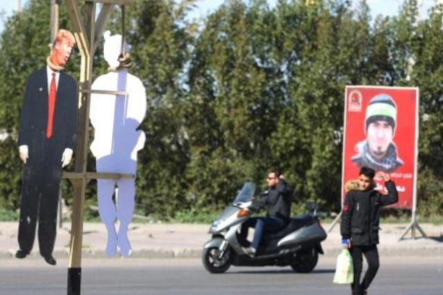 آدمک ترامپ در بغداد به دار آویخته شد+ تصاویر