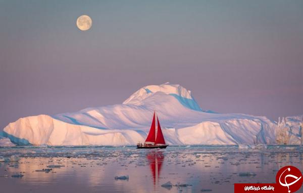 قایقی در احاطه کوه یخ در عکس روز نشنال جئوگرافیک