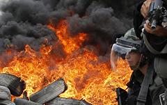 باشگاه خبرنگاران -تصاویر روز: از اعتراض فعالان محیط زیست در انگلیس تا حضور آنگلا مرکل در کنفرانس مطبوعاتی سالانهاش در آلمان