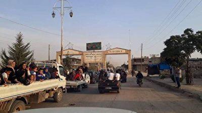 فرار مردم مناطق شمالی سوریه در پی حمله نیروهای ترکیه