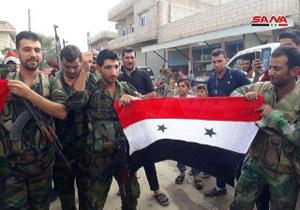 پرچم سوریه در شهر عینالعرب به اهتزاز درآمد