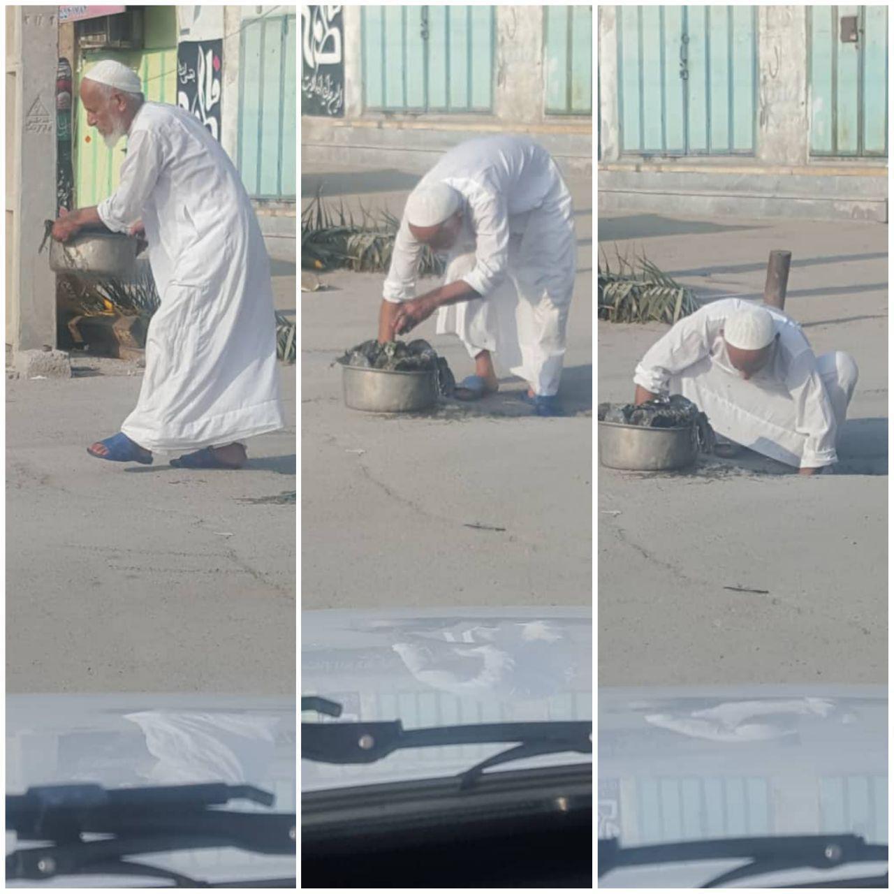 امام جمعه موقت گناوه در حال تمیز کردن ورودی فاضلاب
