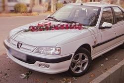 ماشین عروس مزین به عکس شهید بابایی