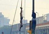 باشگاه خبرنگاران -فیلمی دلخراش از آویزان کردن پیکر نوجوان ۱۶ ساله در میدان الوثبه بغداد