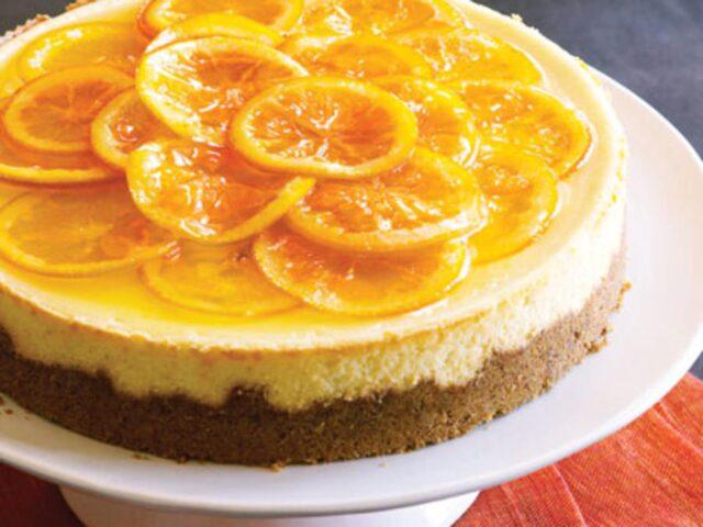 ۲ طرز تهیه چیز کیک پرتقال یخچالی با پایه بیسکویت و کیک اسفنجی