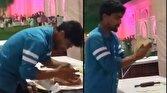 اقدام مشمئزکننده مرد قناد روی شیرینی عروسی!