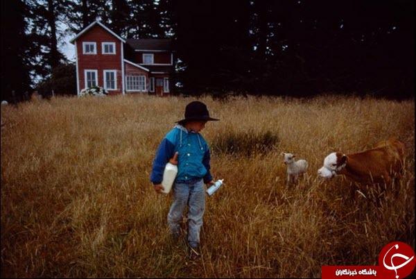 عکس روز نشنال جئوگرافیک از دوستی یک کودک با حیوانات خانوادگی