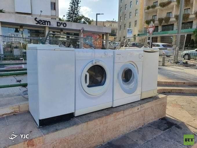 معترضان در برابر خانه نتانیاهو «ماشین لباسشویی» قرار دادند+ تصویر